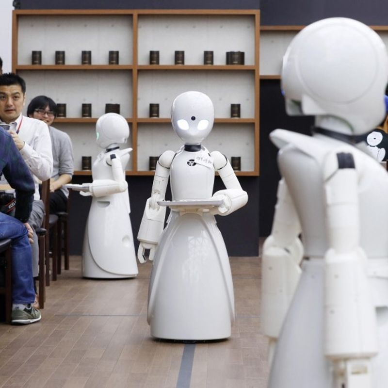 Cafe opens with robot waiters remotely controlled by disabled people photo