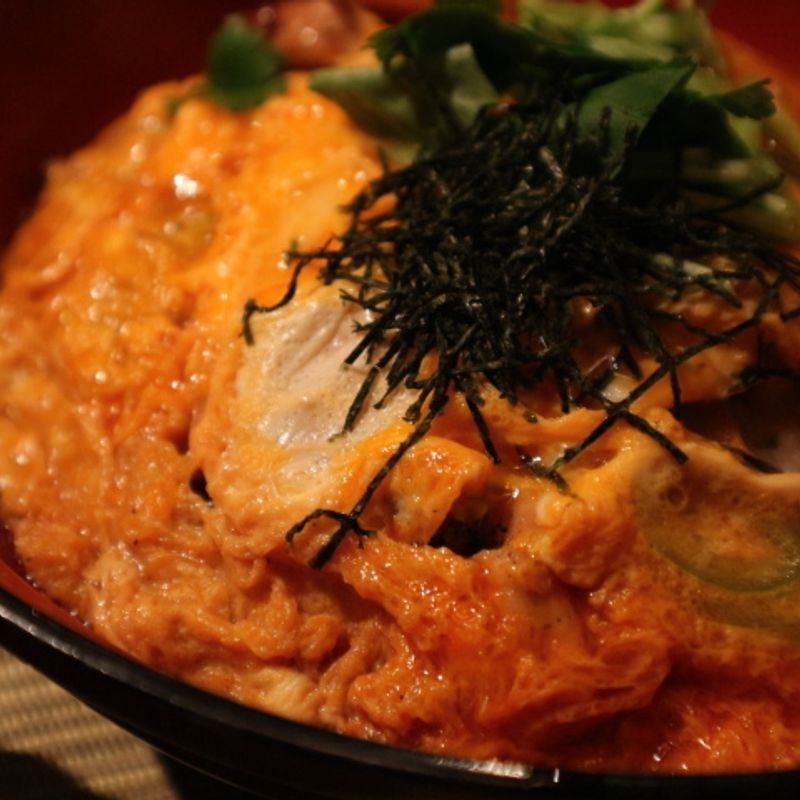 Oyakodon with chicken grilled over coal. Unusual apparently. photo