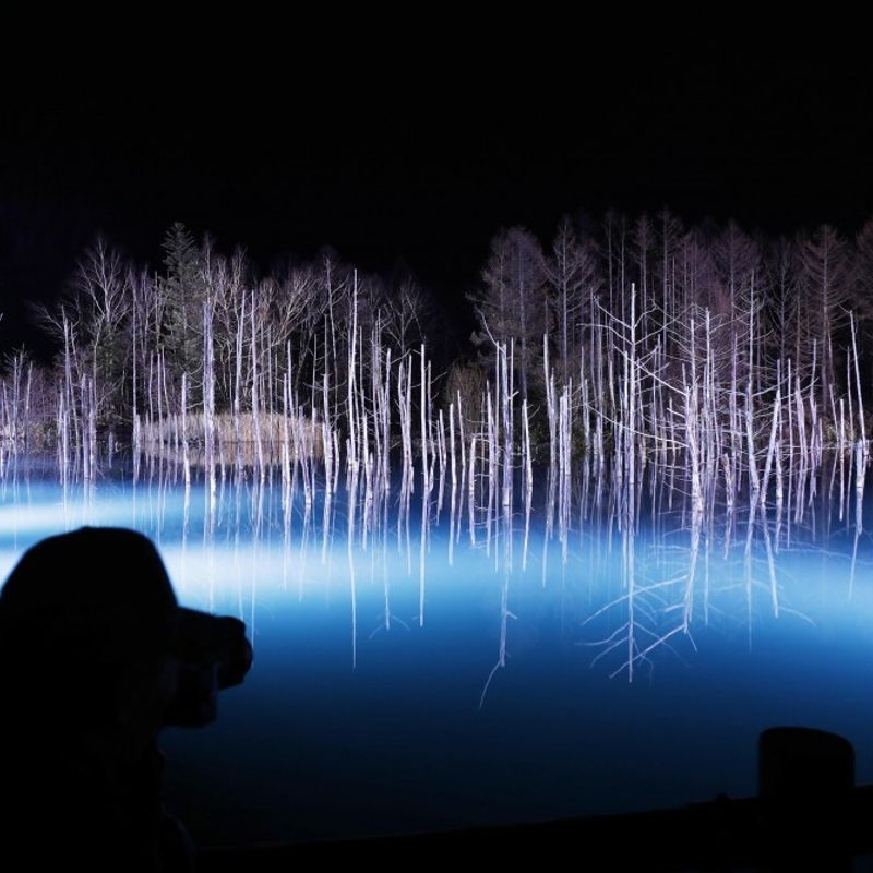Tourists treated to Blue Pond in northern Japan photo