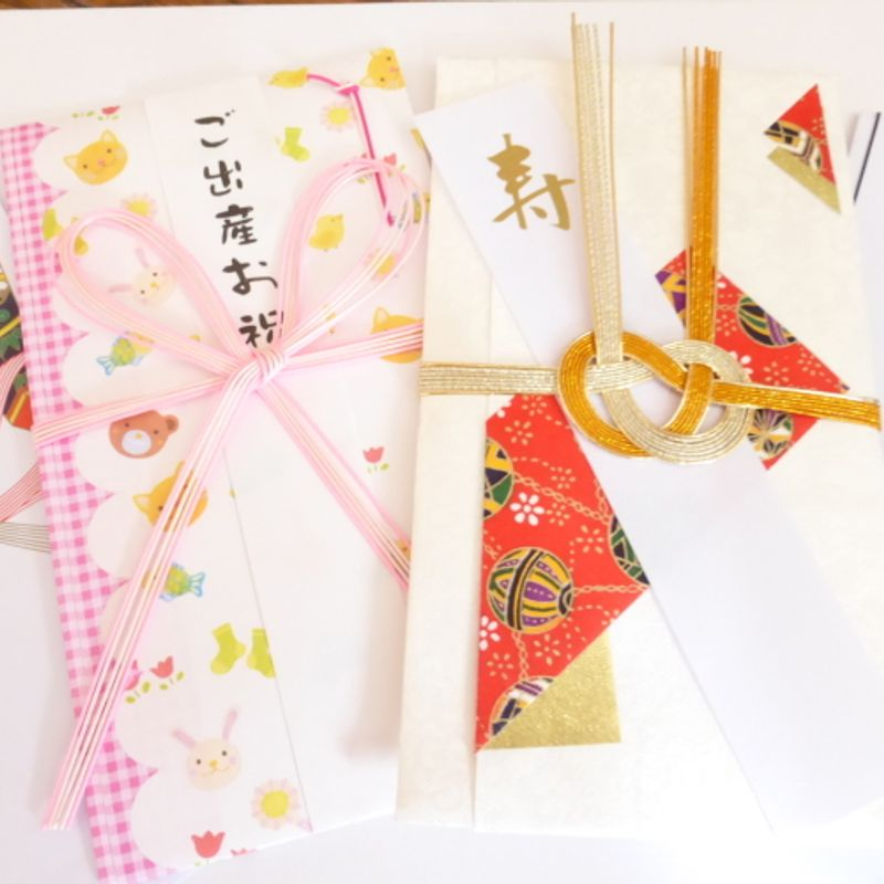 Envelopes and Notes:  Handing Over Hard Cash at a Japanese Ceremony photo