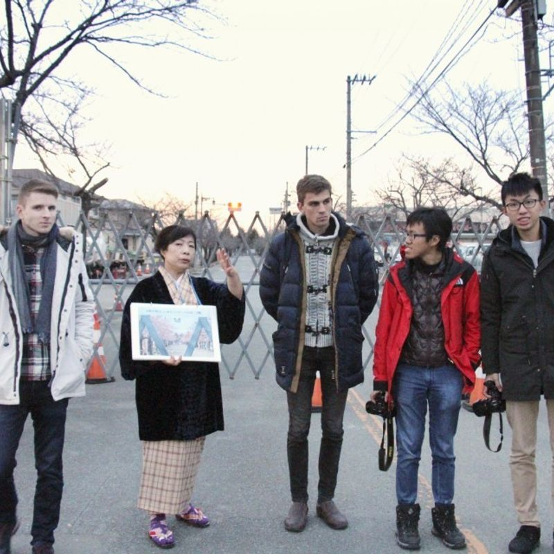 Tour brings foreigners to areas devastated by nuclear accident photo