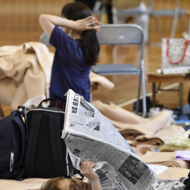 Hundreds in shelters, rain stirs landslide fears in quake-hit Osaka photo