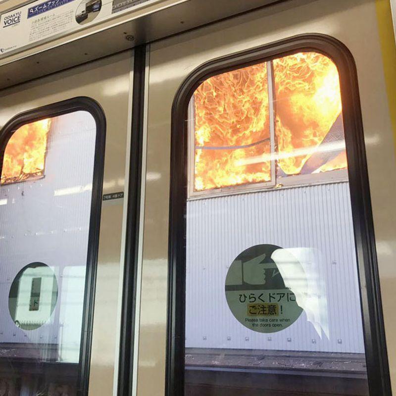 Tokyo commuter train catches fire, 300 passengers evacuate on tracks photo