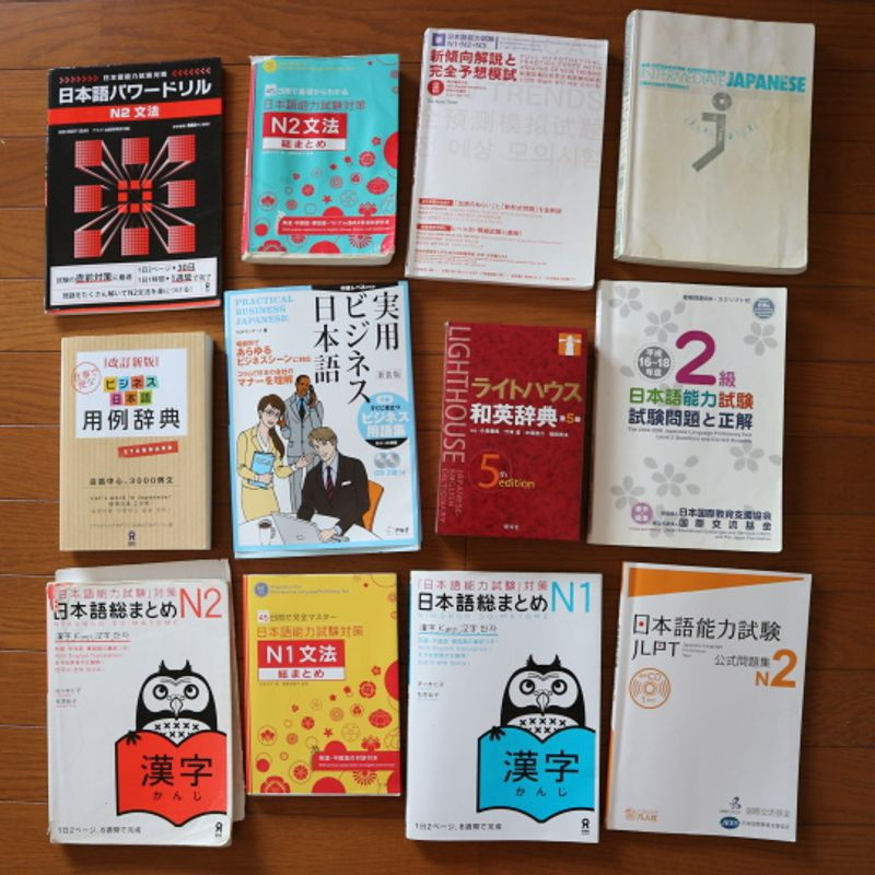 Every textbook we've used to study Japanese, ever!  And how much we spent on them!  photo