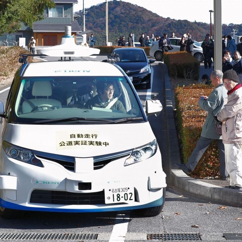 Japan holds 1st self-drive car test on public road photo