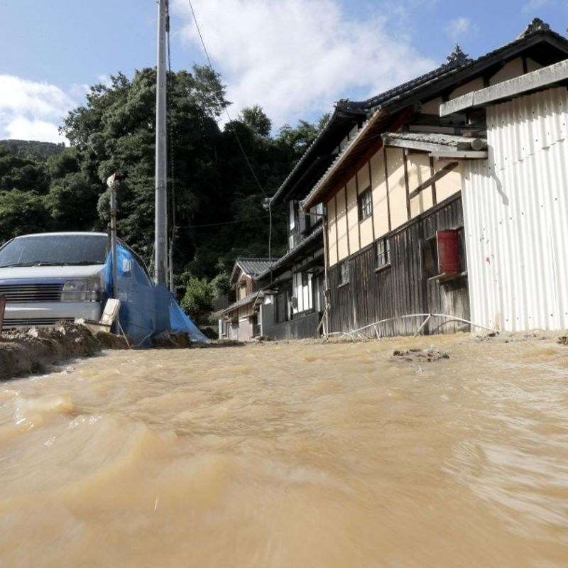Japanese rescuers in race to find missing as flood death toll tops 150 photo