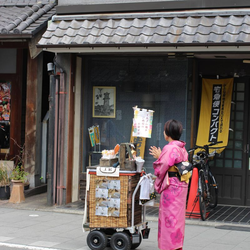 Old style Japanese street peddler photo