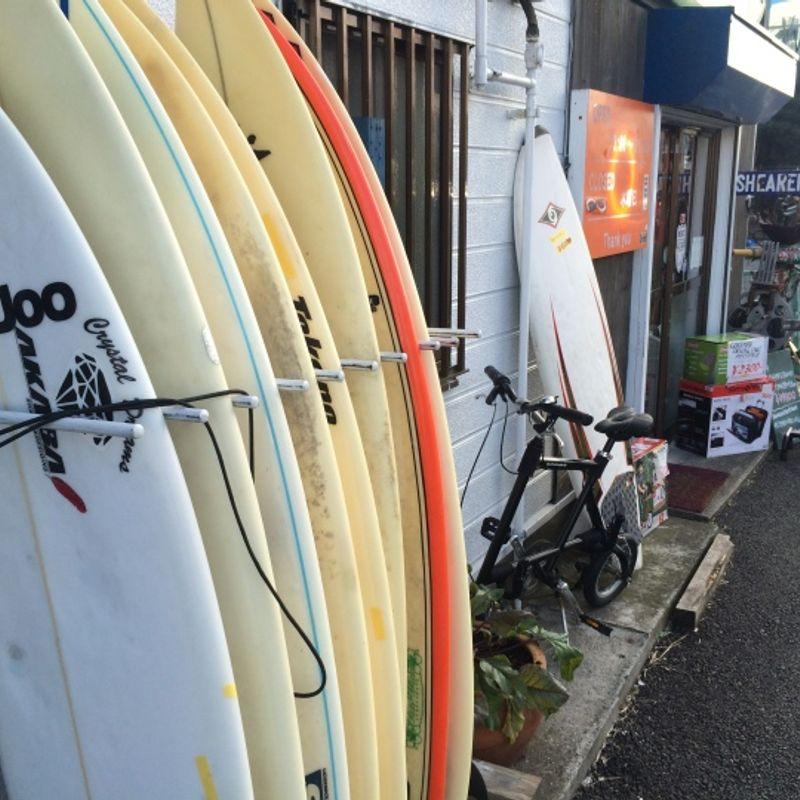 Surf shop in Chiba with a massive dinosaur on the roof! photo
