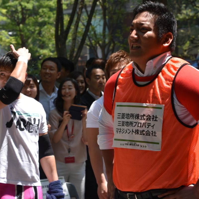 Tokyo's besuited office workers play tug of war on the streets of Marunouchi, Tokyo photo