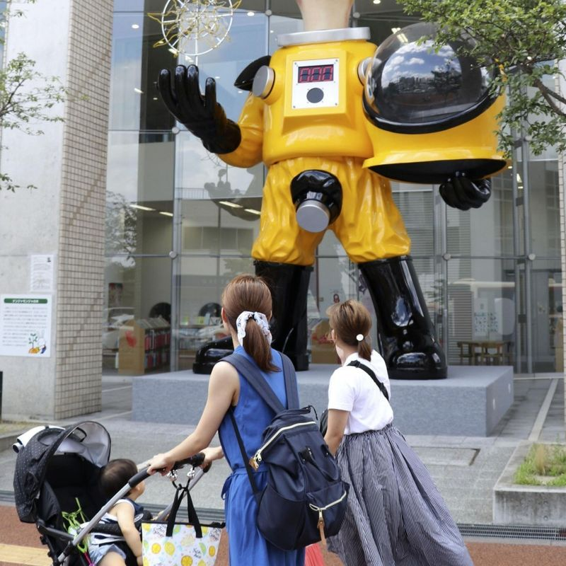 Statue of child in protective suit draws fire in Japan's Fukushima photo