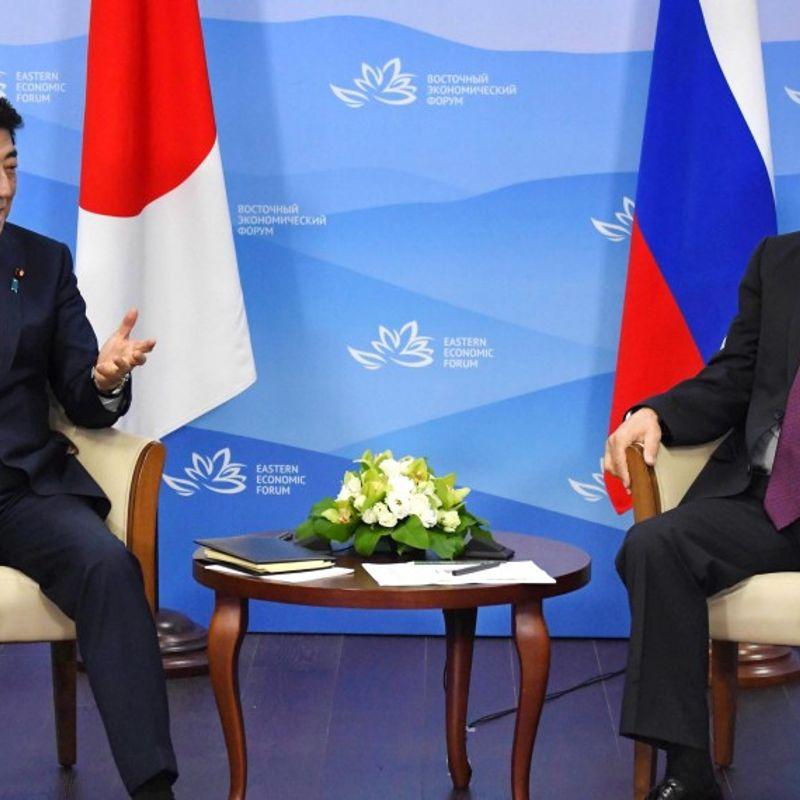 Abe, Putin slam N. Korea nuke test, differ on denuclearization path photo