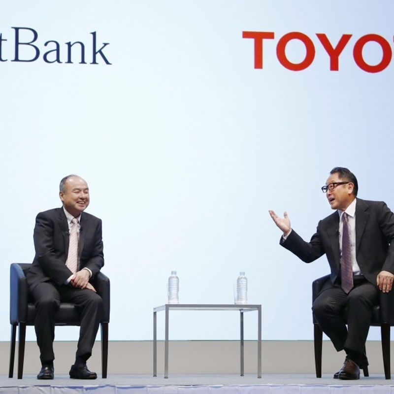 Toyota, SoftBank tie up in developing driverless car services photo