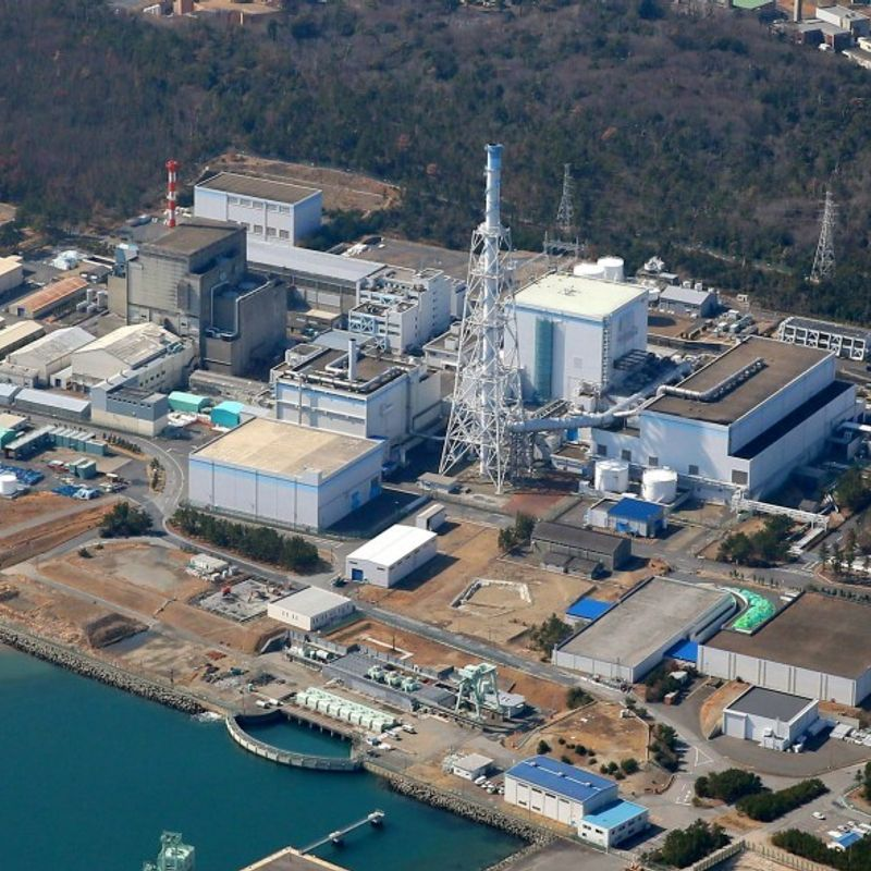 Japan nuclear watchdog OKs restart of aging nuclear plant hit by tsunami photo