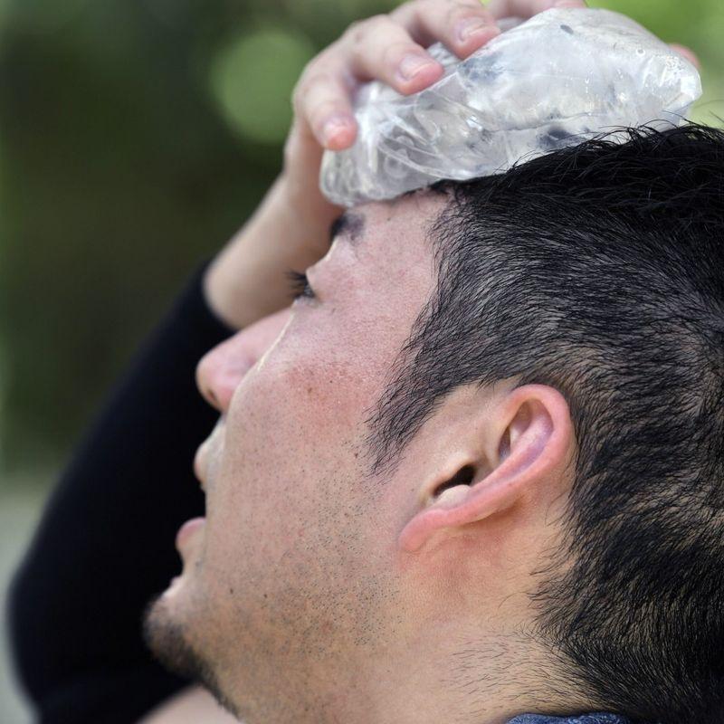Japan logs historic high temperature amid persistent heat wave photo