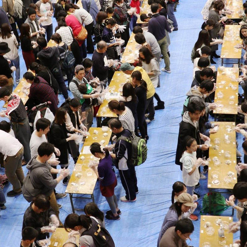 Guinness record set for most people in simultaneous rice ball making photo