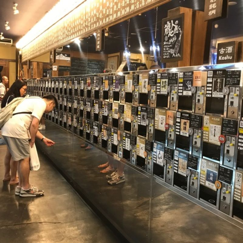 Only in Japan - sake tasting in a train station! photo