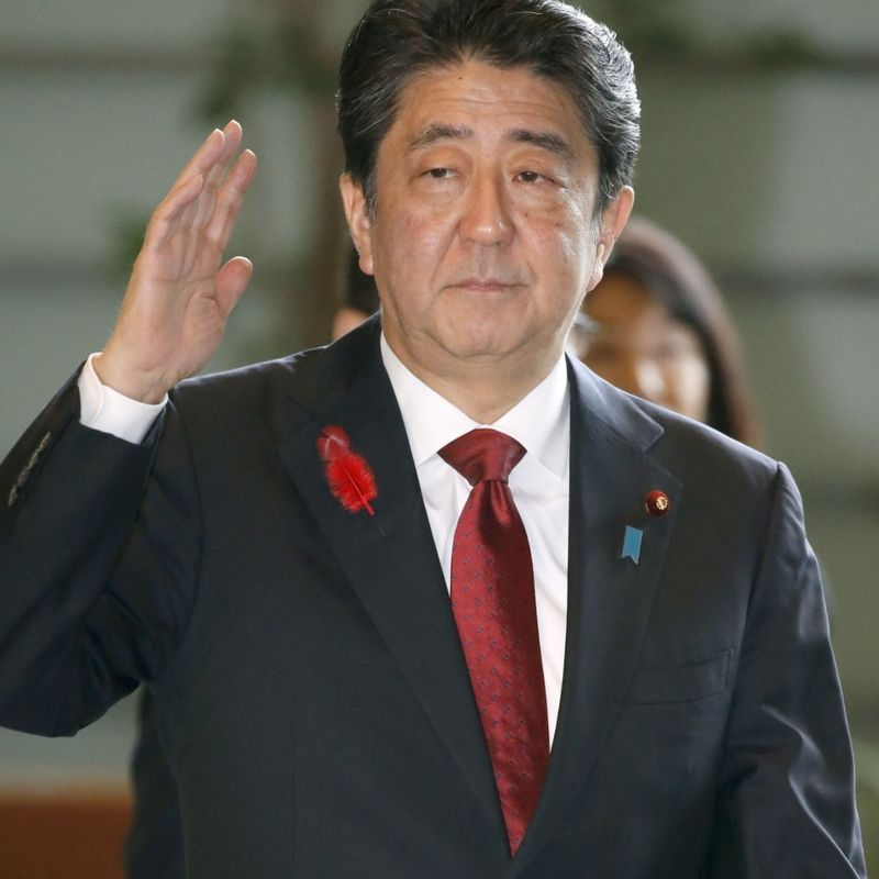 Japan PM Shinzo Abe to announce 2019 consumption tax hike photo