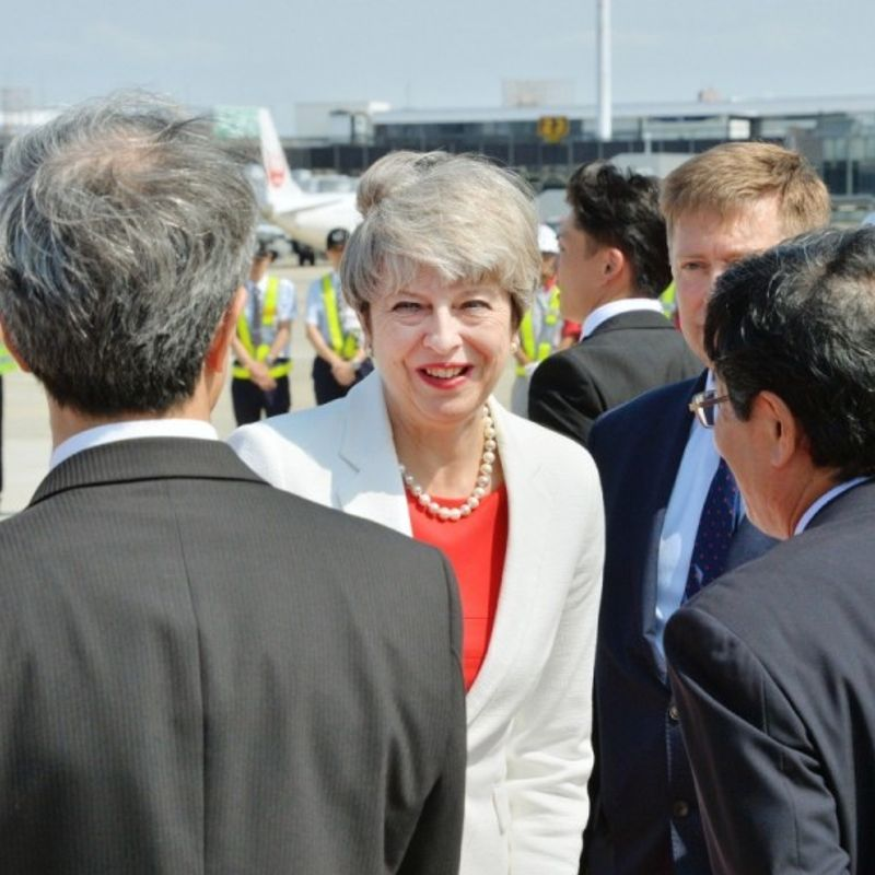 British PM May arrives in Japan for talks with Abe photo