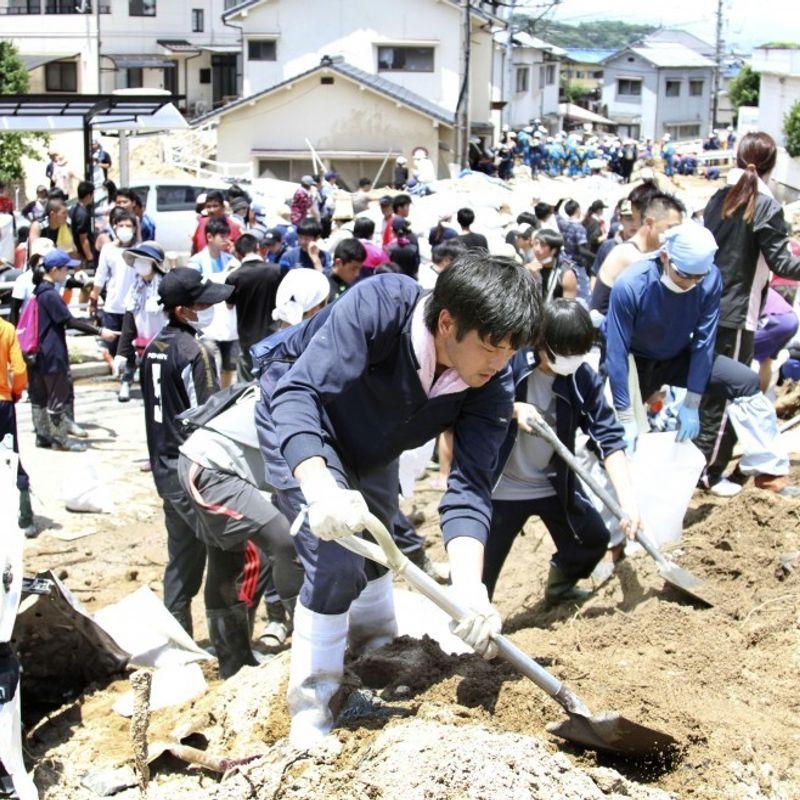Classmates dig out debris in search of Hiroshima student after landslide photo