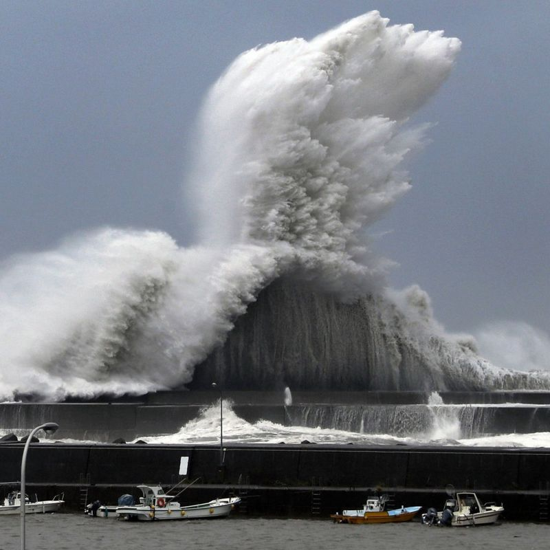 2 dead, many injured as typhoon hits western Japan, shuts down airport photo